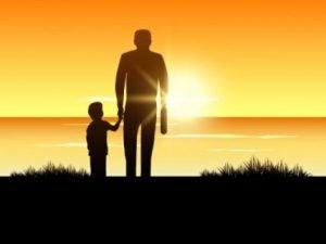 Far och son i solnedgång