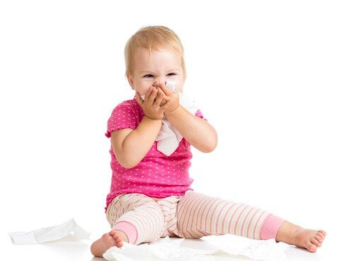 Barn med näsduk