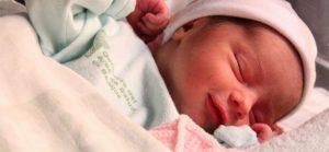 Leende nyfödd