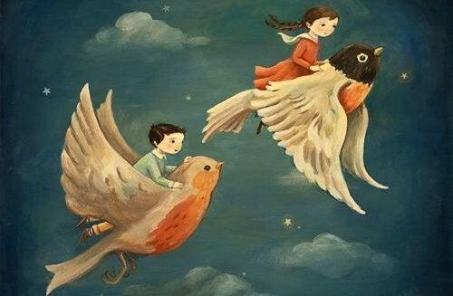 Barn som flyger på fåglar.