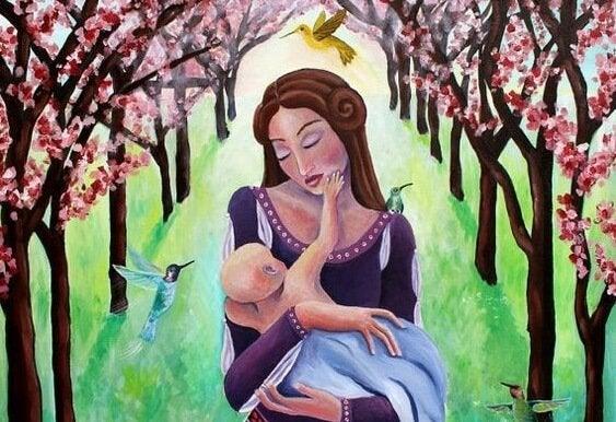 Mamma som håller sitt barn.