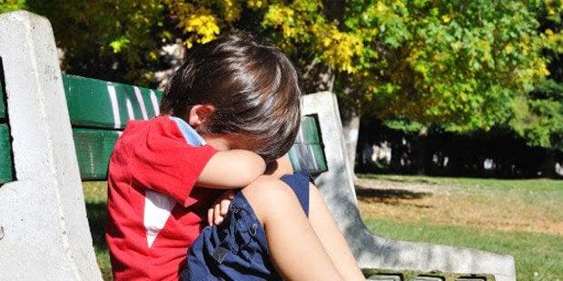 Pojke som är ledsen.