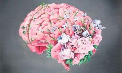 Hjärna med blommor som växer ur den