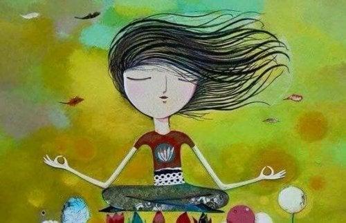 En flicka som mediterar.