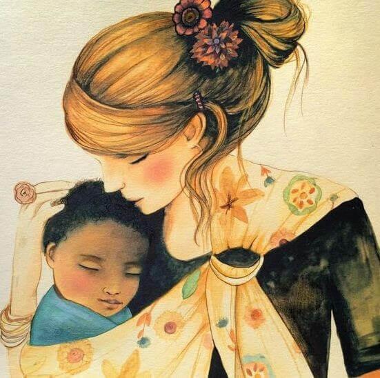mor håller om baby i slinga