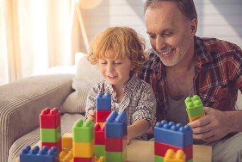 Pappa och barn bygger med stort lego tillsammans.