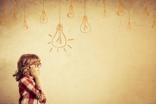 fundersamt barn vid vägg med målade glödlampor