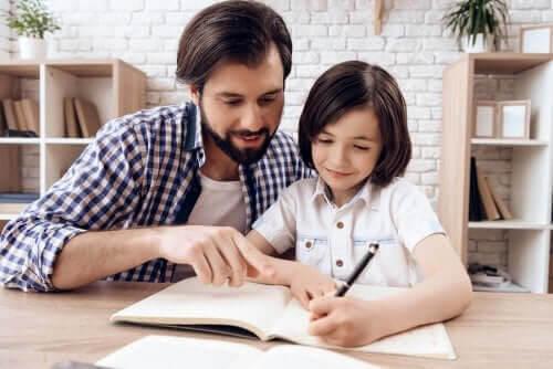 utrymme för läxläsning: pappa hjälper dotter med läxor